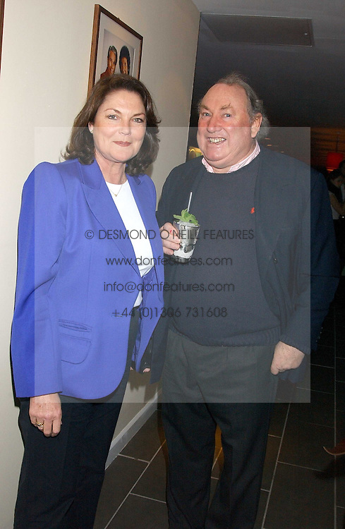 ANTHONY & ANTOINETTE OPPENHEIMER at the opening party for a new bowling alley All Star Lanes, at Victoria House, Bloomsbury Place, London on 19th January 2006.<br />