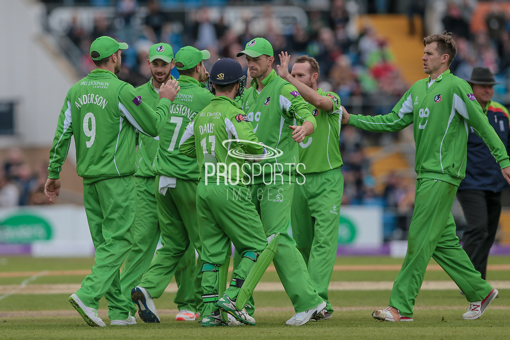 The Lancashire Lightning players celebrate getting the wicket of Peter Handscomb (Yorkshire Vikings) who is caught by Anderson (bowled Procter) for 86 during the Royal London 1 Day Cup match between Yorkshire County Cricket Club and Lancashire County Cricket Club at Headingley Stadium, Headingley, United Kingdom on 1 May 2017. Photo by Mark P Doherty.