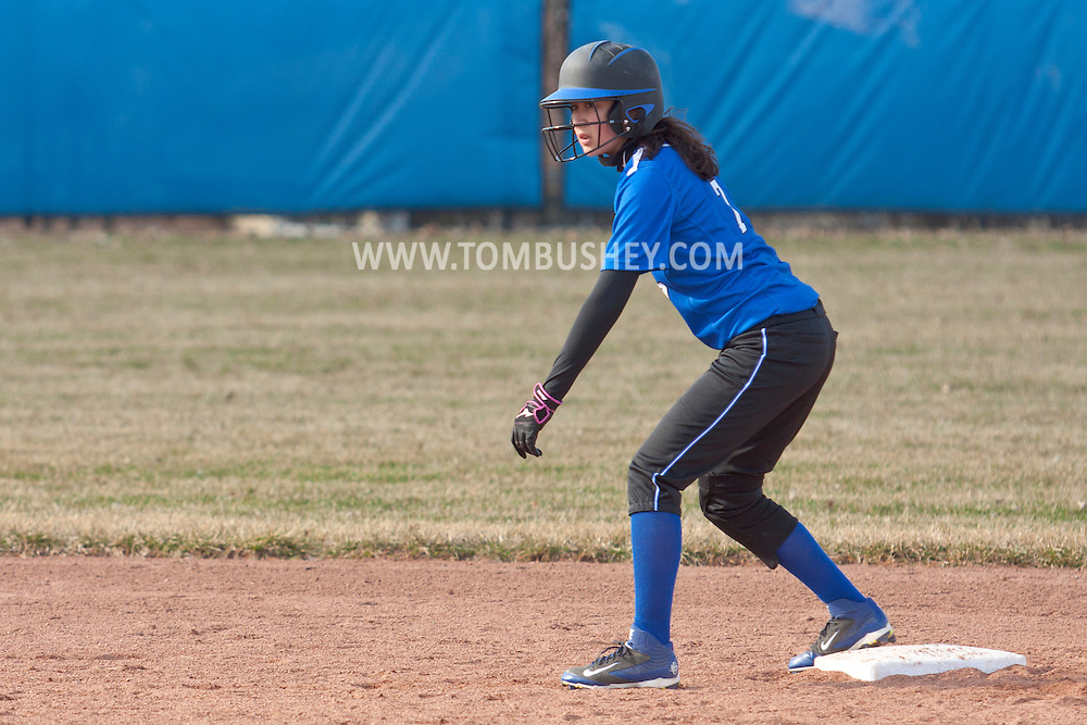 Middletown, New York - A  Middletown baserunner gets ready to run from second base in a varsity girls' softball game on April 9, 2014.