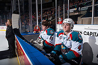 KELOWNA, CANADA - JANUARY 17: Brodan Salmond #31 and Gordie Ballhorn #4 of the Kelowna Rockets sit on the bench at the start of the game against the Lethbridge Hurricanes on January 17, 2018 at Prospera Place in Kelowna, British Columbia, Canada.  (Photo by Marissa Baecker/Shoot the Breeze)  *** Local Caption ***