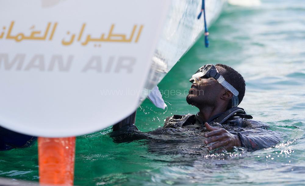 La Route des Princes. Valencia. Spain.<br /> Oman Air - Musandam's Suleiman Al Manji(OMA) cleaning the hull<br /> Credit: Lloyd Images