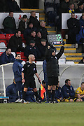 The 4th Official P Cook shows 12 minutes extra time after the injury to Michael Woods during the Sky Bet League 2 match between Hartlepool United and AFC Wimbledon at Victoria Park, Hartlepool, England on 28 February 2015. Photo by Stuart Butcher.