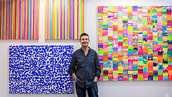 © Licensed to London News Pictures. 06/10/2016. London, UK. Artist, Colin McCallum shows his works at the preview of Moniker Art Fair, part of London Art Week, taking place at the Old Truman Brewery, near Brick Lane.  Now in its seventh year, the fair embraces contemporary art from emerging and established artists, the majority of whom attend the fair in person in order to meet potential collectors and to show their work. Photo credit : Stephen Chung/LNP