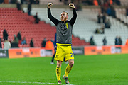 Liam Boyce of Burton Albion celebrates towards the travelling fans after his goal seals the victory after the EFL Sky Bet League 1 match between Sunderland and Burton Albion at the Stadium Of Light, Sunderland, England on 26 November 2019.