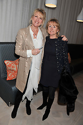 Left to right, LOUISE FENNELL and LORRAINE SPENCER at a party to celebrate the publication of Fame Game by Louise Fennell held at Grace, West Halkin Street, London on 12th March 2013.