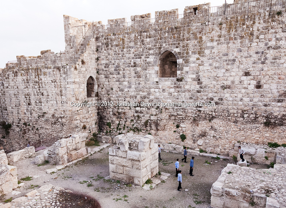 A group of boys at play in the Jewish Quarter of the Old City of Jerusalem. WATERMARKS WILL NOT APPEAR ON PRINTS OR LICENSED IMAGES.