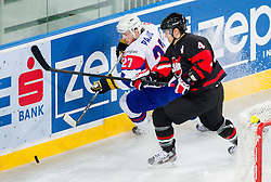 Rok Pajic of Slovenia vs Aaron Keller of Japan during ice-hockey match between Slovenia and Japan at IIHF World Championship DIV. I Group A Slovenia 2012, on April 16, 2012 in Arena Stozice, Ljubljana, Slovenia. (Photo by Vid Ponikvar / Sportida.com)