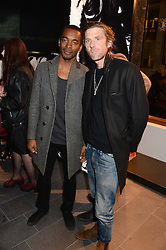 Left to right, AKI OMOSHAYBI and PAUL ANDERSON at the opening of the Tiger of Sweden Store, 210 Piccadilly, London on 3rd October 2013.