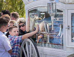 © Licensed to London News Pictures. 21/08/2018. Epsom, UK. Close family members touch the horse drawn hearse at the funeral of traveller Mikey Connors in Epsom cemetery. 32 year-old Mikey Connors, the nephew of My Big Fat Gypsy Wedding star Paddy Doherty, was killed when his horse-and-cart was hit by a car in Thamesmead on July 28. Photo credit: Peter Macdiarmid/LNP