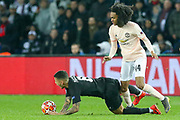 Manchester United Forward Tahith Chong fouls Leandro Paredes during the Champions League Round of 16 2nd leg match between Paris Saint-Germain and Manchester United at Parc des Princes, Paris, France on 6 March 2019.
