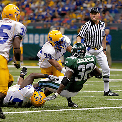 Sep 26, 2009; New Orleans, LA, USA; Tulane Green Wave running back Andre Anderson (32) scores a touchdown past McNesse State Cowboys defenders cornerback Seth Thomas (33) and defensive tackle Damion Aultman (55) at the Louisiana Superdome. Tulane defeated McNeese State 42-32. Mandatory Credit: Derick E. Hingle-US PRESSWIRE