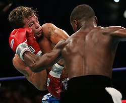 WBC Junior Welterweight Champion Arturo Gatti (l) and challenger Floyd Mayweather trade punches during their 12 round bout at Boardwalk Hall in Atlantic City, NJ.  Floyd Mayweather won the fight via 7th round stoppage.