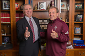 Coach Fisher visits the Office of President Young