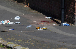 © Licensed to London News Pictures. 11/06/2018. London, UK. Blood stains, medical dressings and gloves are seen on the pavement after a 17 year old was critically injured in a stabbing in Harrow last night. Police are also dealing with a stabbing incident in nearby Northolt where a 20 year old was injured. Photo credit: Peter Macdiarmid/LNP  Photo credit: Peter Macdiarmid/LNP