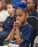 A student listens to comments during a stop of the Listen & Learn tour at Marshall Elementary School, September 20, 2016.