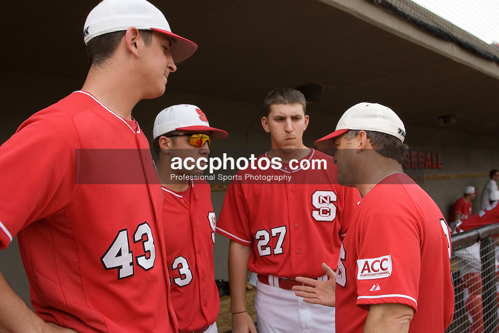 14 March 2007: North Carolina State Wolfpack head coach Elliott Avent (right) speaks with pitcher Eric Surkamp (43), pitcher Nate Karns (33) and pitcher Jimmy Gillheeney (27) during a 9-4 win over Valparaiso at Doak Field in Raleigh, NC.