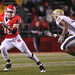 Oct 16, 2009; Piscataway, NJ, USA; Pittsburgh linebacker Greg Williams (38) pursues Rutgers running back Joe Martinek (38) during second half NCAA football action in Pittsburgh's 24-17 victory over Rutgers at Rutgers Stadium.