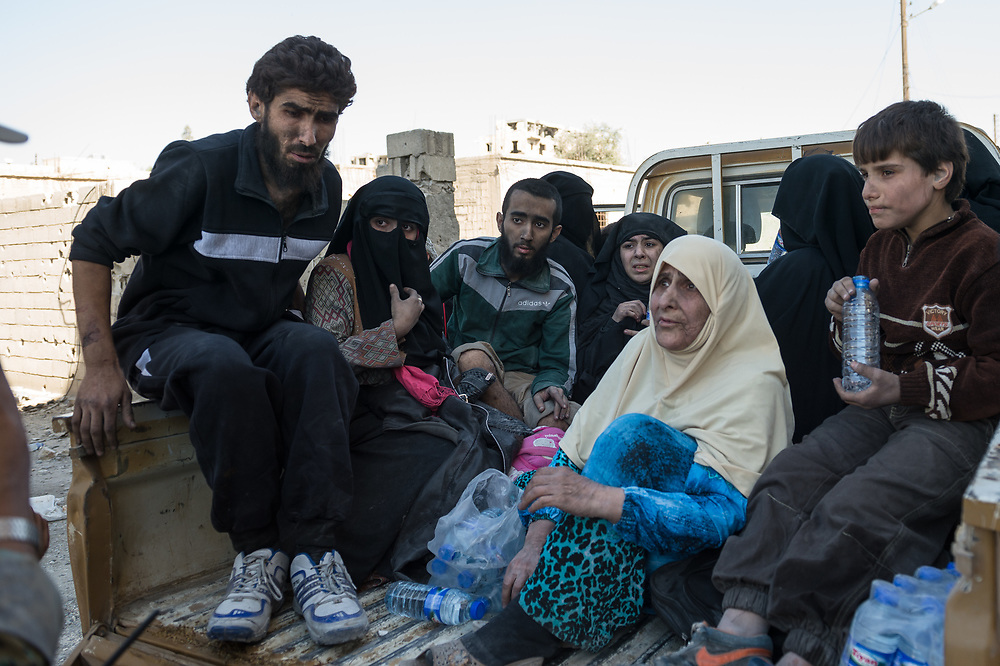 A group of people arriving in the eastern part of Raqqa. They were evacuated by SDF from an embattled district in Raqqa, Syria, October12,2017