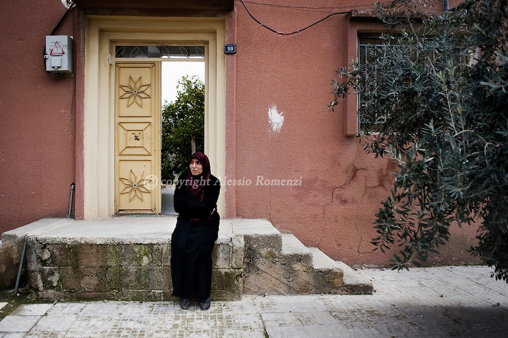 SYRIA - Al Qsair. A Syrian woman, is seen as the funeral of a member of  the Free Syrian Army, killed in Al Qsair, is passing in front of her house on February 9, 2012. ALESSIO ROMENZI