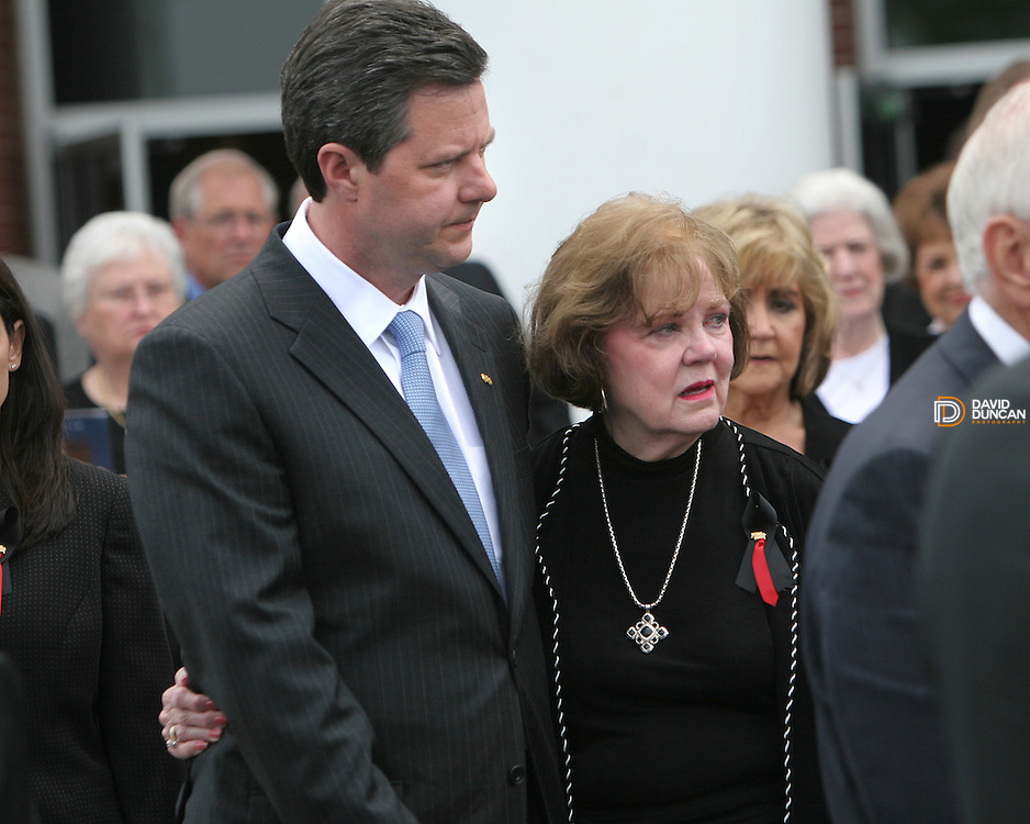 Jerry Falwell Jr. oldest son of the late Rev. Jerry Falwell holds his mother, Macel, after Falwell's casket was placed in the hearse outside of Thomas Road Baptist Church Tuesday May 22nd, 2007 in Lynchburg, VA. About 10,000 mourners stood in line to attend the services..Photo by David Duncan.