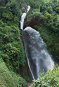 A water fall shoots out near Tolka, Nepal.