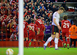 LIVERPOOL, ENGLAND - Thursday, March 10, 2016: Liverpool's Roberto Firmino celebrates scoring the second goal against Manchester United during the UEFA Europa League Round of 16 1st Leg match at Anfield. (Pic by David Rawcliffe/Propaganda)