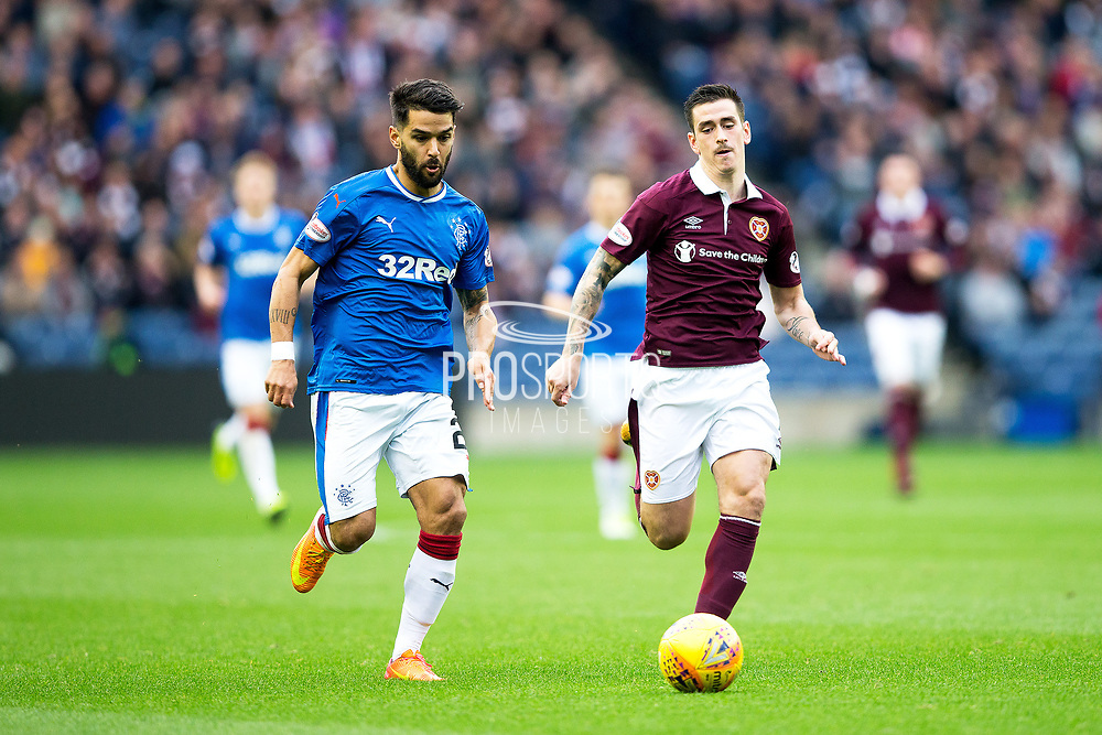 Alfredo Morelos (#20) of Rangers and Jamie Walker (#7) of Heart of Midlothian pursue the loose ball during the Ladbrokes Scottish Premiership match between Heart of Midlothian and Rangers at Murrayfield, Edinburgh, Scotland on 28 October 2017. Photo by Craig Doyle.