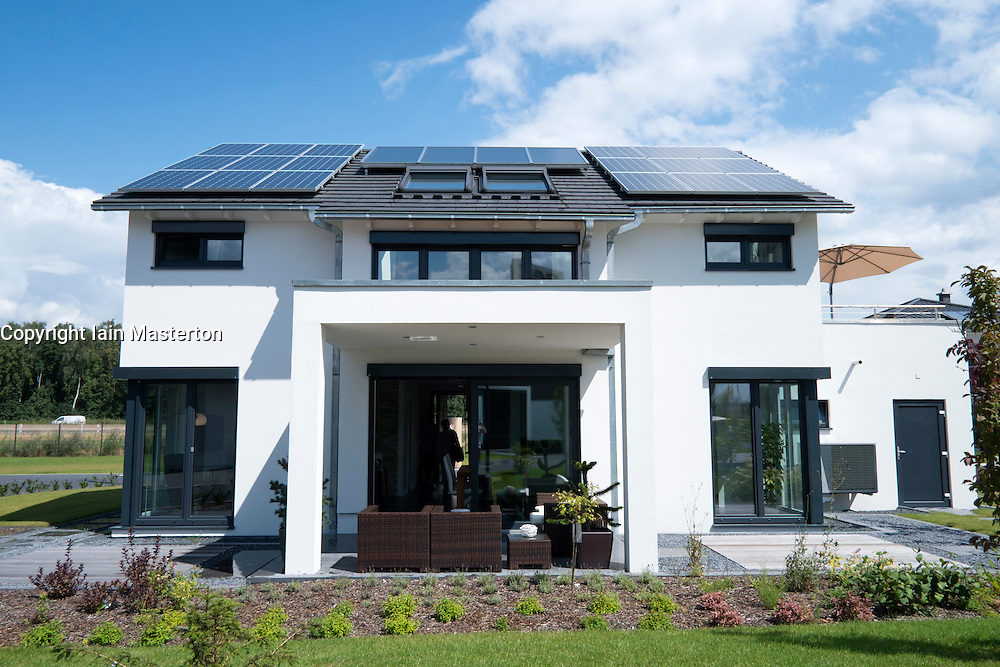 Modern highly energy efficient family house with solar panels on