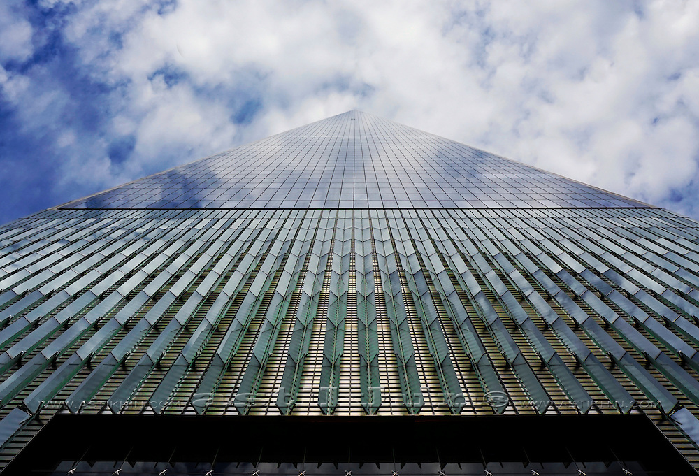 Clouds reflected into windows of Freedom Tower.