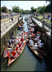 Swan Uppers take part in the Annual Swan Upping Ceremony on <br /> The  River Thames in West London, United Kingdom. Swan Upping is the annual census of the Swan population on stretches of the Thames.<br /> Monday, 15th July 2013<br /> Picture by Andrew Parsons / i-Images