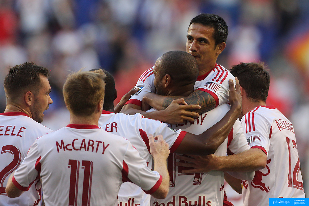 Tim Cahill, New York Red Bulls, is congratulated after scoring by team mate Thierry Henry during the New York Red Bulls V Real Salt Lake, Major League Soccer regular season match at Red Bull Arena, Harrison, New Jersey. USA. 27th July 2013. Photo Tim Clayton