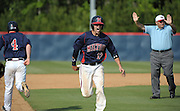 Milton's Nick Bradshaw (12) reacts after his double, which sets up the winning run when pinch runner Andrew Wood (4) later scores on an eighth inning hit in their GHSA AAAAAA State Baseball Championship game against Roswell, Monday, May 27, 2013, in Milton, Ga.   David Tulis/AJC Special