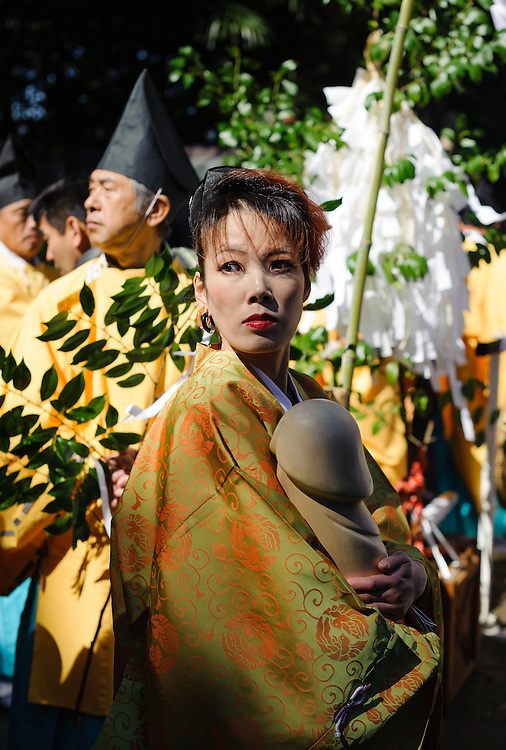 A woman carries a wooden phallus during Honen-sai, a fertility festival at Tagata Shrine in Komaki, Aichi Prefecture, Japan. The traditional Shinto festival celebrates fertility and a bountiful harvest. The principal offering during the festival is a large wooden phallus. Each year a craftsman carves a new phallus from a Japanese cypress tree. It measures almost 2.4 meters (13 feet) long and weights 280kg (620 pounds).