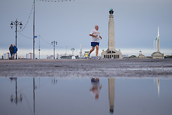 © Licensed to London News Pictures. 29/09/2016. Portsmouth, Hampshire, UK.  A runner on Southsea Promenade this morning, 29th September 2016. Wet and windy weather hits the south coast following days of warm sunny weather. Photo credit: Rob Arnold/LNP