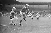 Wexford attacks Cork player from behind as he jumps in the air during the All Ireland Senior Hurling Final, Cork v Wexford in Croke Park on the 5th September 1976. Cork 2-21, Wexford 4-11.