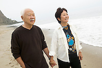 Senior couple on beach holding hands