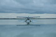 Float plane making water landing
