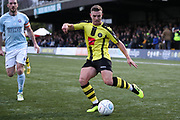 Harrogate Town forward Jack Muldoon (18) crosses the ball during the Vanarama National League match between FC Halifax Town and Dover Athletic at the Shay, Halifax, United Kingdom on 17 November 2018.