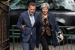 © Licensed to London News Pictures . 30/04/2018. Manchester , UK. British Prime Minister THERESA MAY arrives for a visit at Brooklands Primary School in Sale , with headmaster MATTHEW COPPING (l) . May is facing questions over her role in the scandal of the way Windrush migrants have been treated and after the resignation of Home Secretary, Amber Rudd, late last night (29 April 2018) . Photo credit : Joel Goodman/LNP