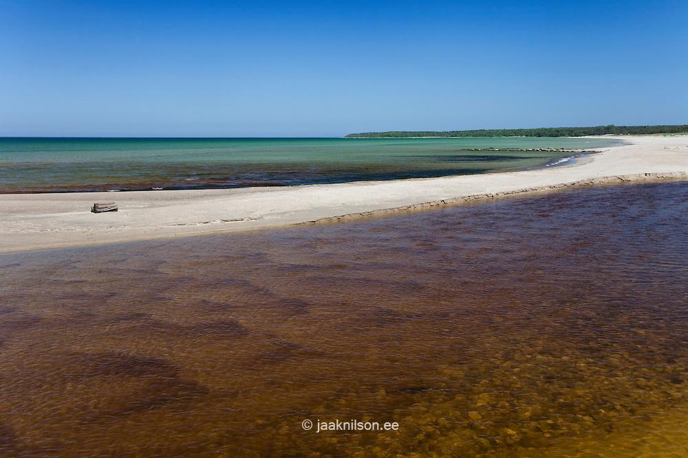 Sandy beach in Vääna-Jõesuu river mouth, Harju county, Estonia, Europe. Baltic sea.