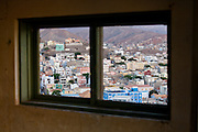 The town of Mindello, Cape Verde seen through the window of an abandoned building.