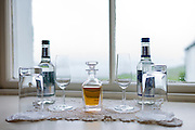 Decanter of sherry with glasses in guest bedroom of upmarket Ullinish Lodge Hotel at Struan, Isle of Skye, Western Isles of Scotland
