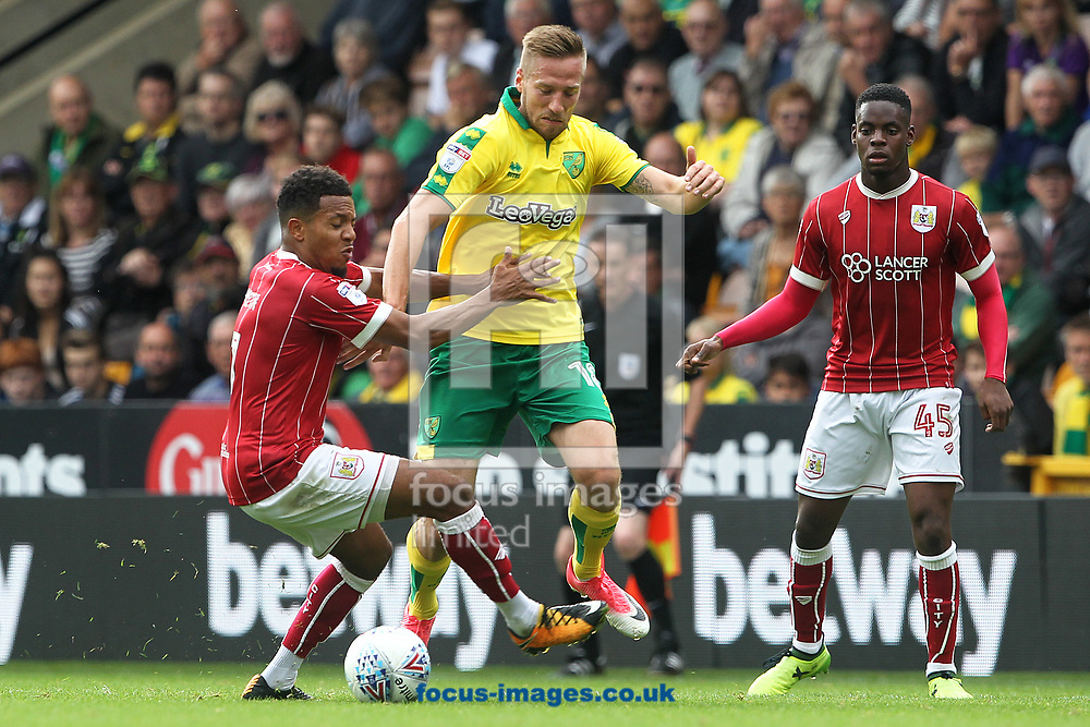 Korey Smith of Bristol City and Marco Stiepermann of Norwich in action during the Sky Bet Championship match at Carrow Road, Norwich<br /> Picture by Paul Chesterton/Focus Images Ltd +44 7904 640267<br /> 23/09/2017