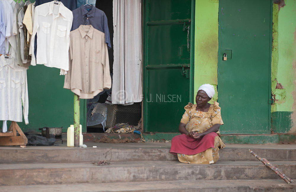 Old woman in front of her shop not far from Bulenga, a suburb to Kampala, Uganda.