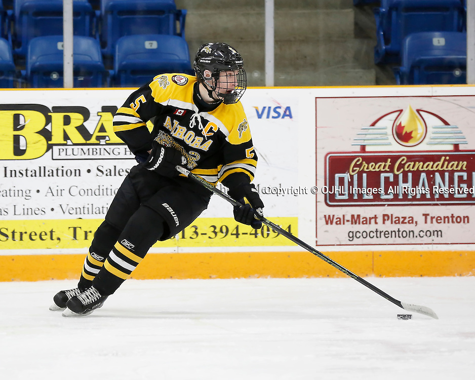 TRENTON, ON - JAN 24,  2017: Ontario Junior Hockey League action game between Aurora and Wellington at the 2017 Winter Showcase, Eric Holland #5 of the Aurora Tigers skates with the puck during the second period<br /> (Photo by Amy Deroche / OJHL Images)