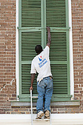 A worker secures hurricane shutters on a historic home in preparation for Hurricane Irma on the Battery September 8, 2017 in Charleston, South Carolina. Imra is expected to spare the Charleston area but hurricane preparations continue as Irma leaves a path of destruction across the Caribbean.