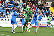 Tom Elliott forward for AFC Wimbledon (9) battles for possession during the Sky Bet League 2 match between Hartlepool United and AFC Wimbledon at Victoria Park, Hartlepool, England on 25 March 2016. Photo by Stuart Butcher.