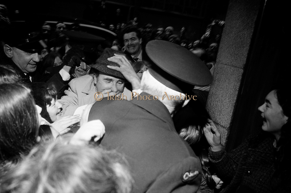 'Jim Figgerty', (holding hat) the man who put the figs in fig rolls, returns to Jacobs after a three-month absence and is mobbed by fans. Part of a hugely successful marketing campaign based on the question 'How do Jacobs get the figs in the fig roles?' Figgerty, and his sidekick, Habibi, (who asked the question in French) became part of the national consciousness..19.03.1969