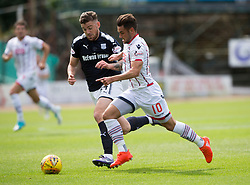 Dundee's Kerr Waddell and Ross County's Alex Schalk. Dundee 1 v 2 Ross County, Scottish Premiership game played 5/8/2017 at Dundee's home ground Dens Park.