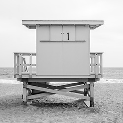 Zuma Beach Malibu California lifeguard tower #1 panorama photo in black and white. Malibu is a coastal beach city in Southern California in the United States of America. Panoramic photo ratio is 1:3. Copyright ⓒ 2015 Paul Velgos with All Rights Reserved.